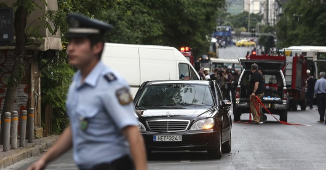 The Latest: Greek govt official describes blast as attack