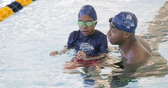 Many poor kids can't swim; Olympic champs throw a lifeline