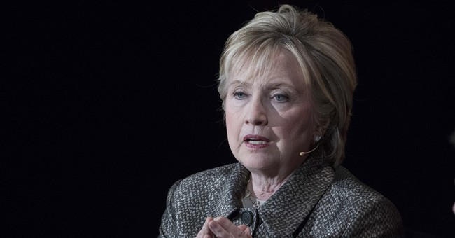 Clinton reappears at Wellesley, again at a crossroads