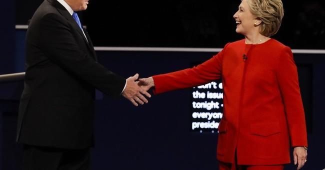 Clinton calls Trump's budget a mean-spirited 'con'