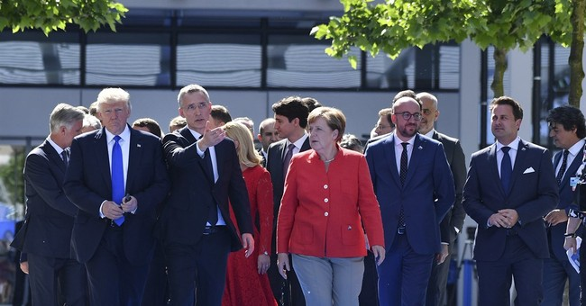 Turkey's leader confronted by France, Germany at NATO summit