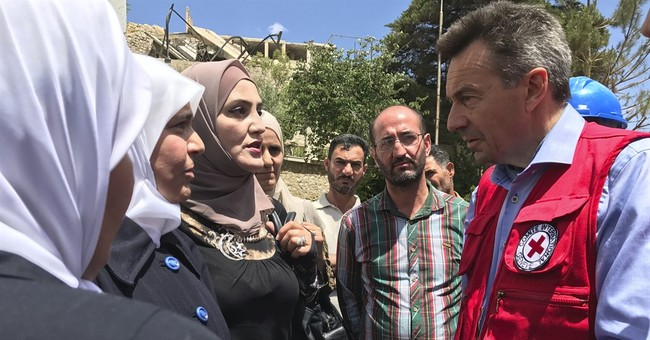 Red Cross says it's stepped up aid across Syrian front lines