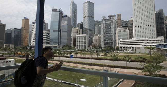 Moody's downgrades Hong Kong credit rating after China cut