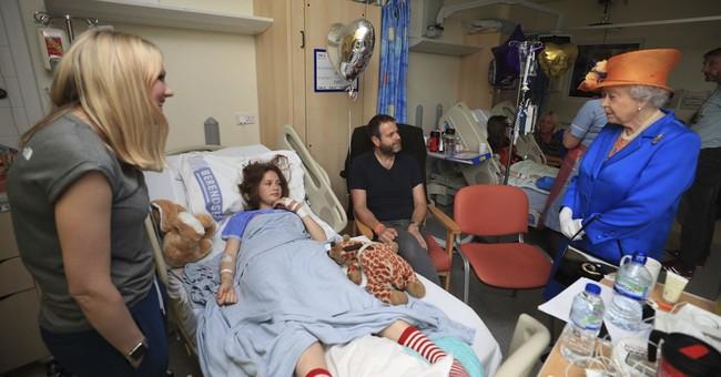 Queen Elizabeth visits young survivors of concert blast
