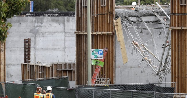 The Latest: Video shows workers dangling at California site