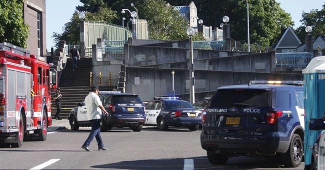 Police: Man hurling racial slurs kills 2, injures 1 on train