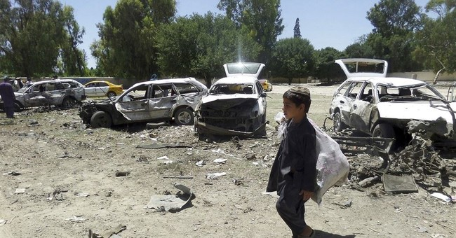 Afghan official says 18 killed in suicide car bomb attack