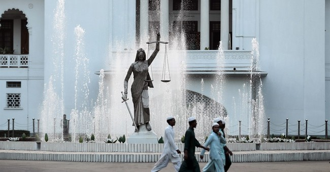 Bangladesh reinstalls justice statue that irked Islamists