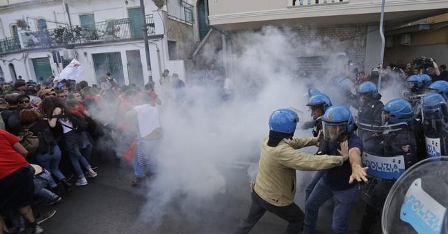 The Latest: Italian police tear gas protesters near G-7 site