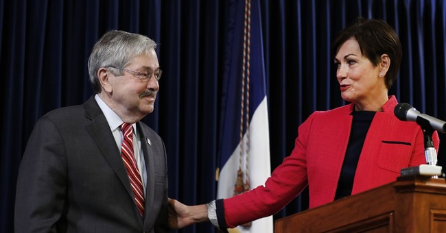 Once an unlikely candidate, Iowa's governor embraces new job