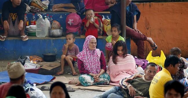 Philippines pounds militants as civilians found shot dead