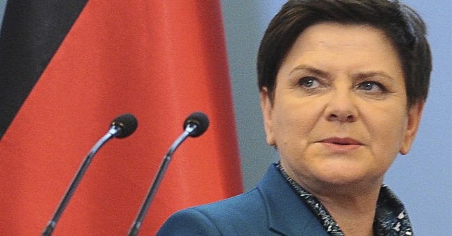 Poland's PM attends first Mass celebrated by her son