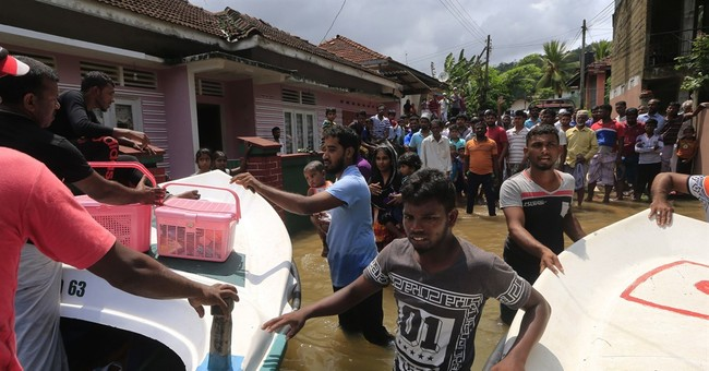 Sri Lanka rescuers find bodies as flood deaths reach 146