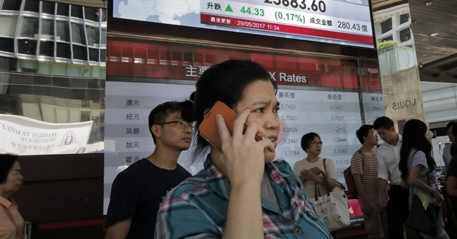 Asian shares muted as investors await raft of economic data