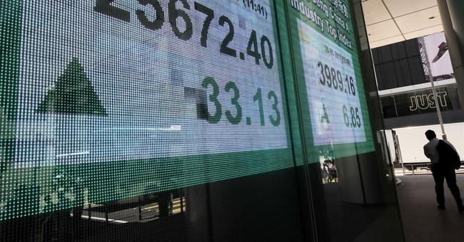 Asian shares weaker as investors await economic data