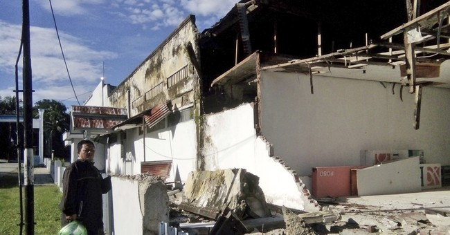 Strong Indonesia earthquake damages buildings, hurts some