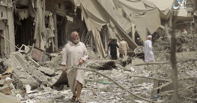 In Syria, more airstrikes hit IS de facto capital of Raqqa