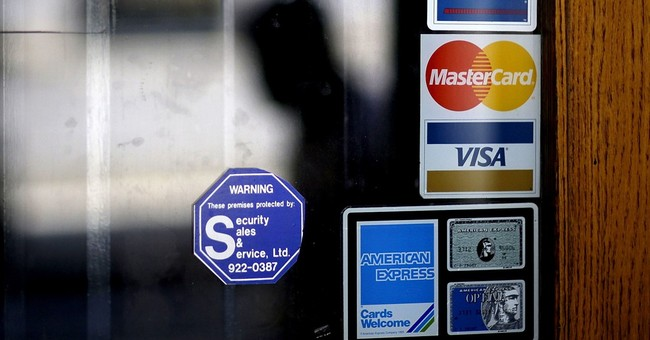 As Americans take on more debt, some pockets of concern