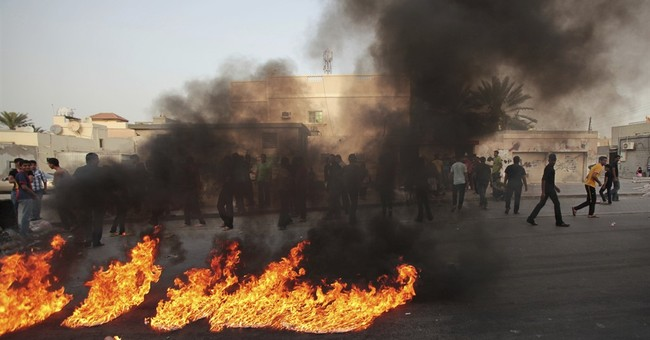 Bahrain executes 3 over police bombing, triggering protests