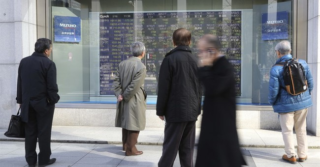 Asian shares mostly lower amid Brexit worries, Takata falls