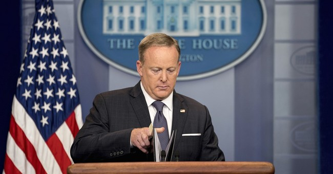 The Latest: Spicer says Trump, Merkel 'get along very well'