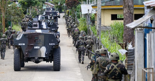Priest says he and 200 others held hostage in Philippines