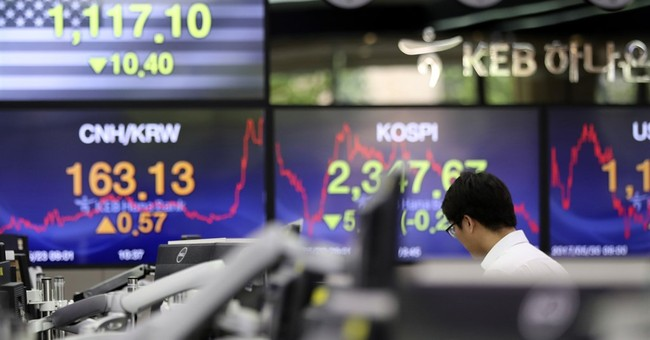 Global shares weaker as investors await economic data