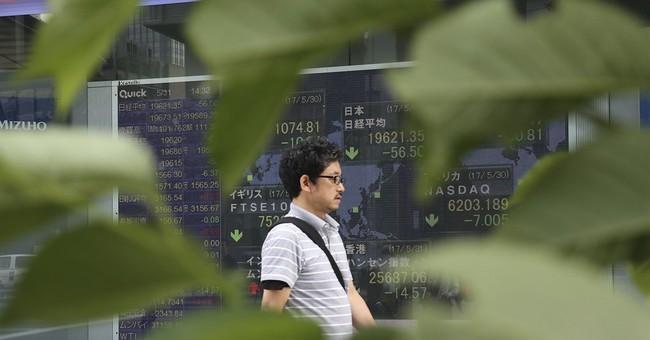 World stocks mixed on US political uncertainty, pound slides