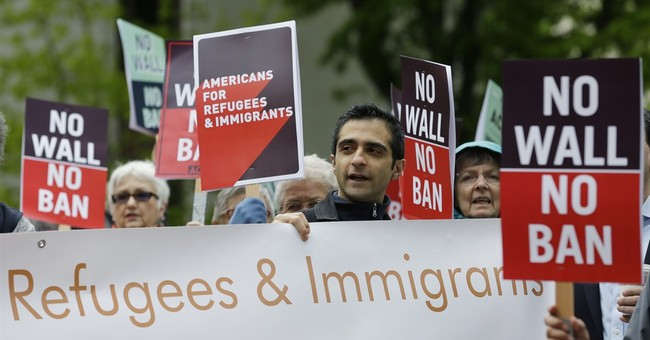 With lawsuits pending, Trump moves to cut refugee admissions