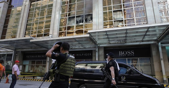 Philippine police seek casino attacker's identity