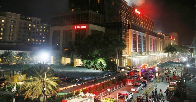 36 die from smoke in Philippine casino after gunman set fire