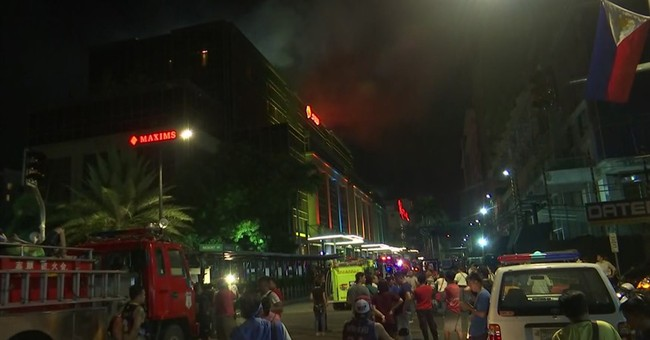 The Latest: Thick smoke had trapped dead in gambling space