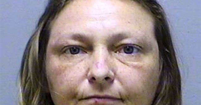 Police say woman stole flowers from cemetery graves