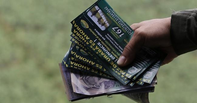 Colombian police drop reward leaflets for drug lord