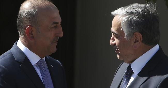 Turkey's FM wants no conditions for Cyprus peace summit