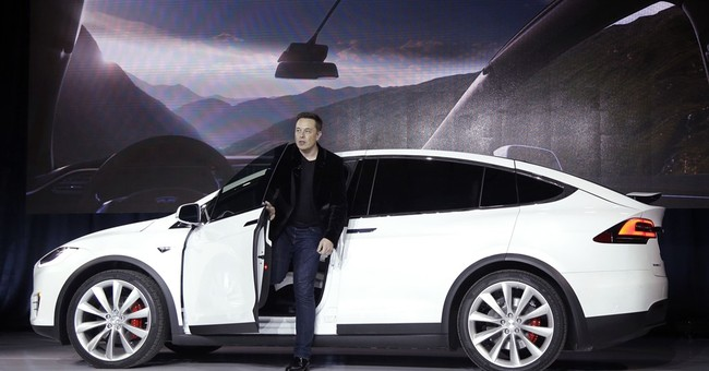 Investors pick Tesla's promise over GM's steady profits