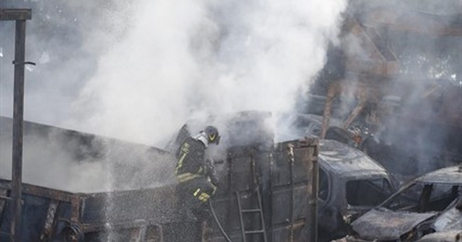 Fire in Rome junkyard explodes gas tanks, spreads dark smoke