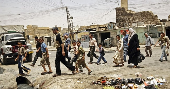 In Iraq, IS seals off area around symbolic mosque in Mosul