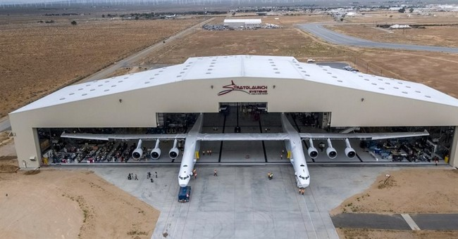 Enormous Stratolaunch aircraft rolled out for first time