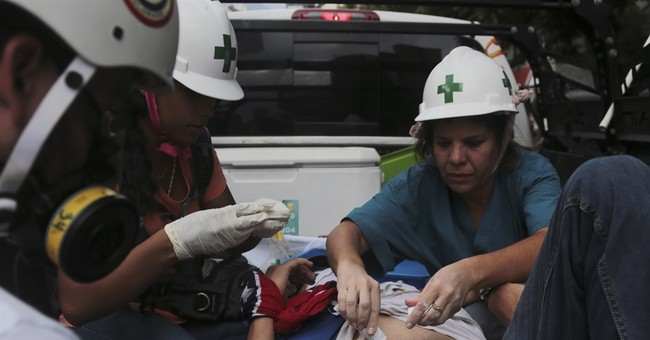 First aid volunteers risk their lives at Venezuela protests
