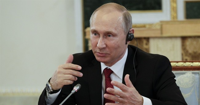The Latest: France says no trace of Russian hacking Macron
