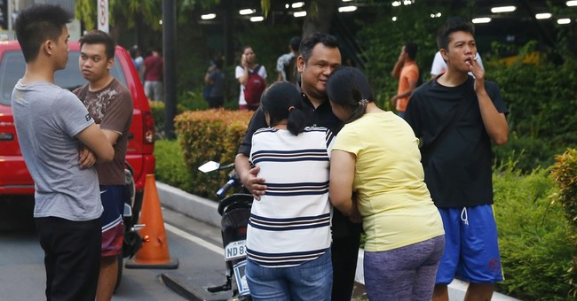The Latest: Filipinos await loved ones' bodies after attack