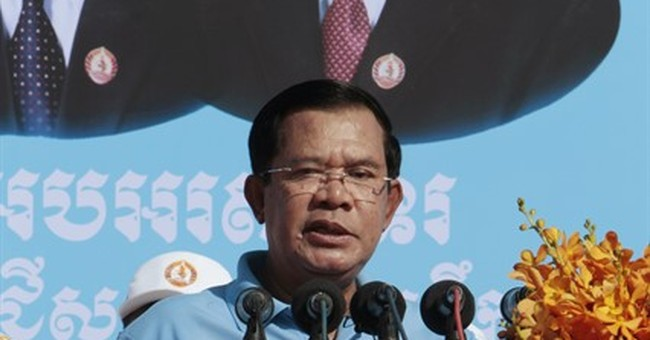 Cambodia's ruler warns opposition not to challenge vote