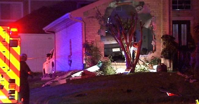 Pickup truck crashes into house, killing 1 in Dallas suburb