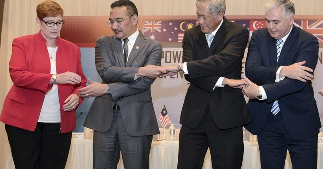 Singapore defense talks focus on online terror fight