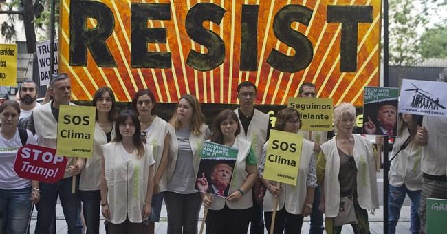 The Latest: EPA chief mum on Trump's beliefs on climate