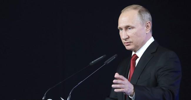 The Latest: Putin ridicules US focus on ambassador contacts