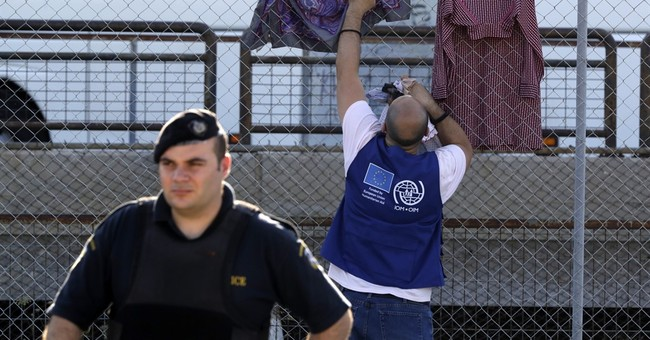 The Latest: Turkey stops about 100 Syrian migrants in 2 days