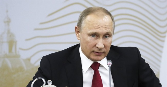 Putin: 'Don't worry, be happy' as Trump ditches climate deal