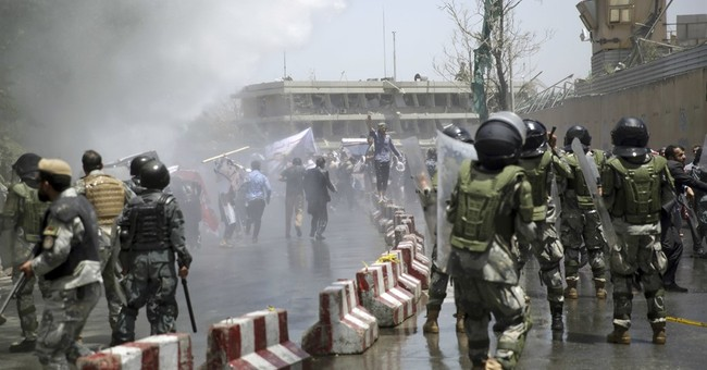 Explosions kill at least 6 at funeral in Kabul